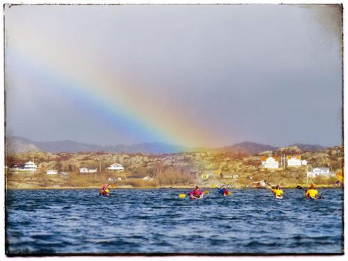 kayaks in the sea on the way to Lådfabriken with rainbow